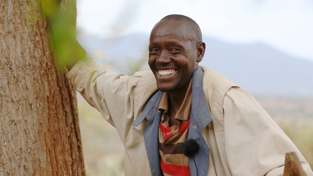 Mulandi Nzama, one of the Better Globe's partner farmers planting Mukau trees on his land.