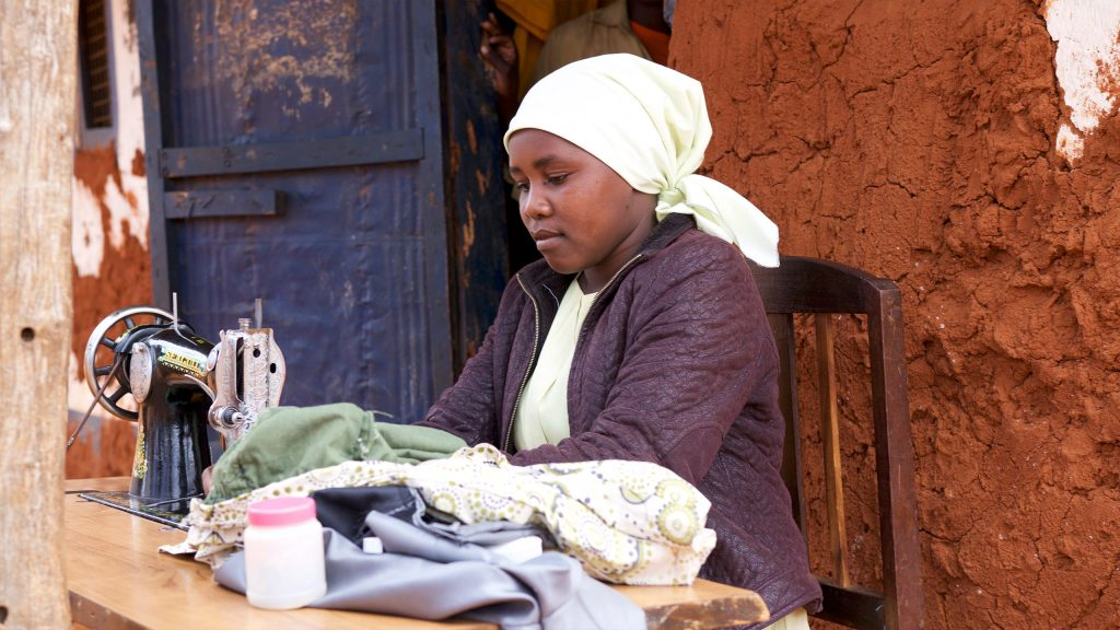 Investing in a sewing machine brings a new income stream for one of the bank's micro-borrowers.